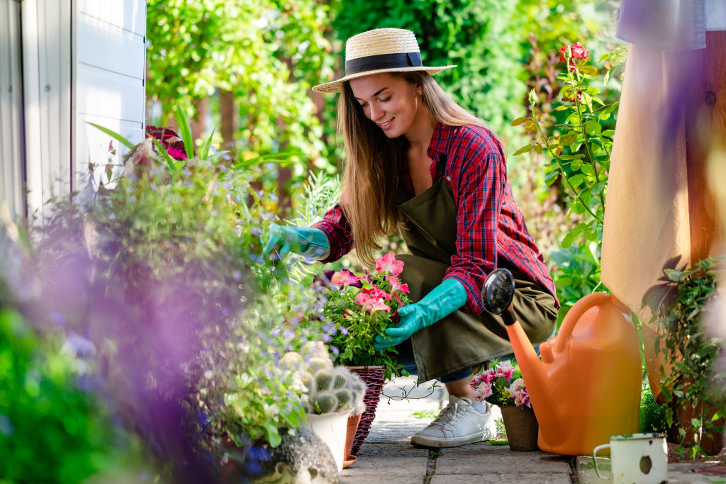 woman tending to her indor plants